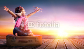 Fototapety Dream journey - Little Girl On Vintage Suitcase At Sunset