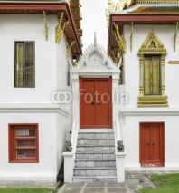 Fototapety Ancient red carving wooden door of Thai temple