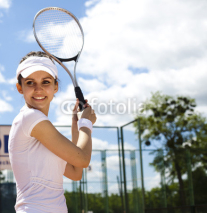 Fototapety Young woman tennis player on the court