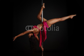 Obrazy i plakaty Woman performing pole dance