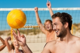Fototapety Friends playing Beach volleyball