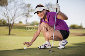 Fototapety Beautiful young woman trying to cheat at golf