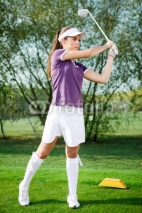 Fototapety Girl golfer hitting the ball
