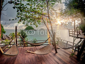 Fototapety Seculed terrace with wooden hammocks