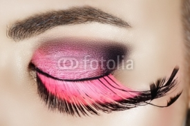 Obrazy i plakaty Macro eye of a woman with pink smoky eyeshadow
