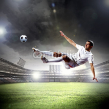 Fototapety football player striking the ball
