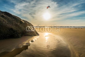 Fototapety Sunset on the beach of Tarifa, with solitary kiter