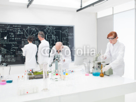 Naklejki Team of scientists in a laboratory
