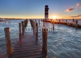 Obrazy i plakaty Lighthouse at Lake Neusiedl at sunset