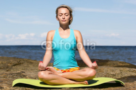 Fototapety young caucasian fitness woman practicing yoga