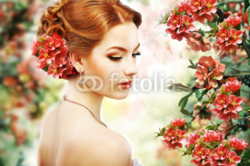 Obrazy i plakaty Red Hair Beauty over Natural Floral Background. Nature. Blossom