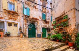 Naklejki view of courtyard in old Rovinj. Croatia.