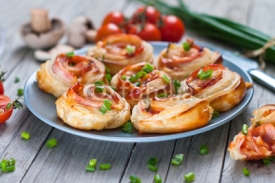 Fototapety Puff pastry rolls with ham and chese. Baked snacks