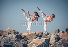 Fototapety Children training karate on the stone coast
