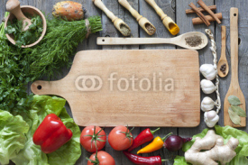 Obrazy i plakaty Vegetables and spices vintage border and empty cutting board