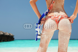Obrazy i plakaty Sexy sandy woman with snorkeling equipment on the beach backgrou