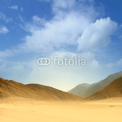 Beautiful image of a sand desert on a blue sky background