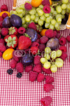 Fototapety tasty summer fruits on a red tablecloth