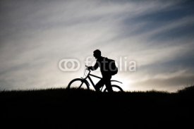 Obrazy i plakaty silhouette of a cyclist on a mountain