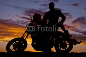 Naklejki woman lay back on motorcycle man stand silhouette