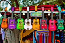 Obrazy i plakaty Colorful Ukeleles on an outdoor cart