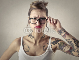 Naklejki Disappointed tattooed girl