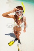 Naklejki Fun woman with snorkeling equipment on the beach