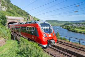 Fototapety Intercity train leaving a tunnel near the river Moselle in Germa