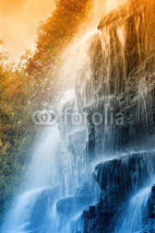 Fototapety amazing waterfall in the natural reserve at sunset