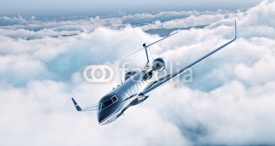 Naklejki Image of black luxury generic design private jet flying in blue sky. Huge white clouds at background. Business travel concept. Horizontal . 3d rendering