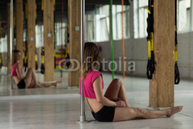 Naklejki Pole dancer resting after training