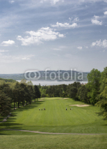 Fototapety Downhill hole with a beautiful view above the golf course