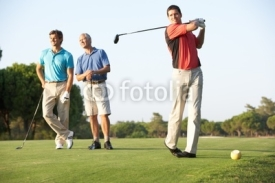 Fototapety Group Of Male Golfers Teeing Off On Golf Course