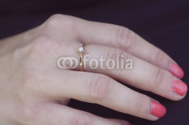 Obrazy i plakaty woman's hand with beautiful engagement ring