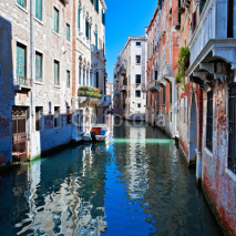 Naklejki View of colored venice canal with houses in water, Italy