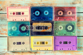 Fototapety Top view (above) shot of retro tape cassette on wood table - vintage color effect styles.