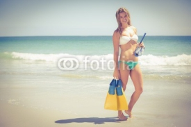 Naklejki Pretty blonde holding a scuba diving gear