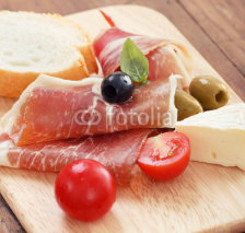 Naklejki sliced prosciutto with olive cheese and Cherry tomato
