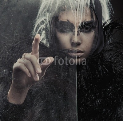 Mysterious woman pointing on something