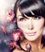 Naklejki Beautiful Healthy Woman with Orchid flower