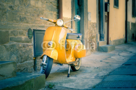 Naklejki Yellow scooter in tuscan Cortona town