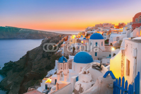 Fototapety Picturesque view, Old Town of Oia or Ia on the island Santorini, white houses and church with blue domes at sunset, Greece