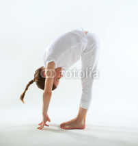 Naklejki Young girl doing yoga
