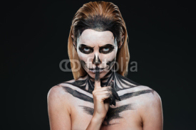 Obrazy i plakaty Portrait of woman with gothic skeleton makeup showing silence gesture