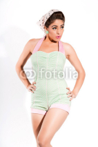Naklejki Sexy fifties pin-up girl with pink lipstick wearing a green and