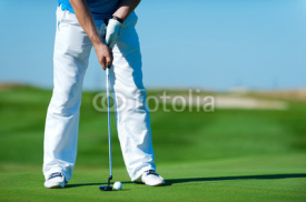 Fototapety Man playing golf