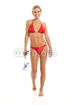 Naklejki Young woman in red bikini holding snorkel