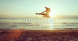 Fototapety flying kick on the beach