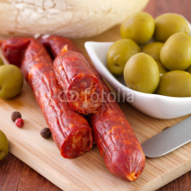 Fototapety sausages with olives in bowl