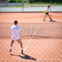 Obrazy i plakaty male tennis match competition on sand court